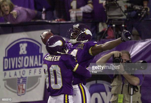 Randy Moss of the Minnesota Vikings celebrates his touchdown with Cris Carter during the third quarter against the New Orleans Saints at the Hubert H...