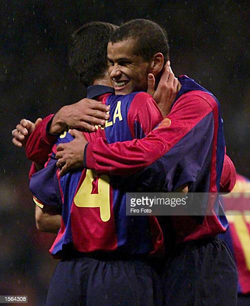 Rivaldo of Barcelona celebrates with a team mate after scoring a goal during the Primera Liga match between Oviedo and Barcelona played at the Neuvo...