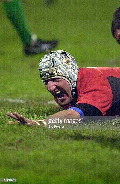Rupert Moon of Llanelli celebrates a scoring a try during the Heineken European Cup Pool 5 match between Llanelli and Colomiers played at Stradey...