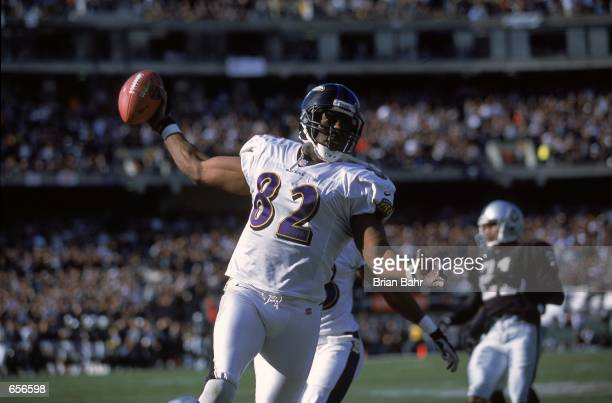 Shannon Sharpe of the Baltimore Ravens celebrates after his 96 yard touchdown as teammate Patrick Johnson runs behind him during the AFC Championship...
