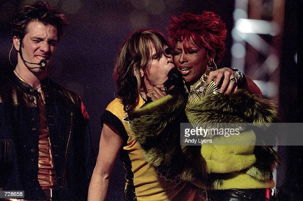 Steve Tyler of Aerosmith peforms with Mary J Blige during the Halftime show of the Super Bowl XXXV Game between the New York Giants and Baltimore...