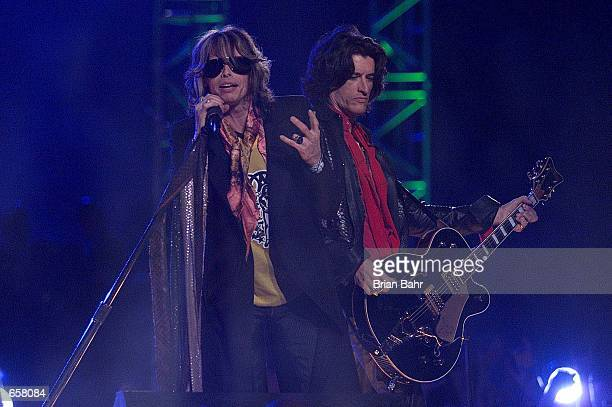 Steven Tyler and Aerosmith perform during the halftime show for Super Bowl XXXV at Raymond James Stadium in Tampa Florida DIGITAL IMAGE Mandatory...