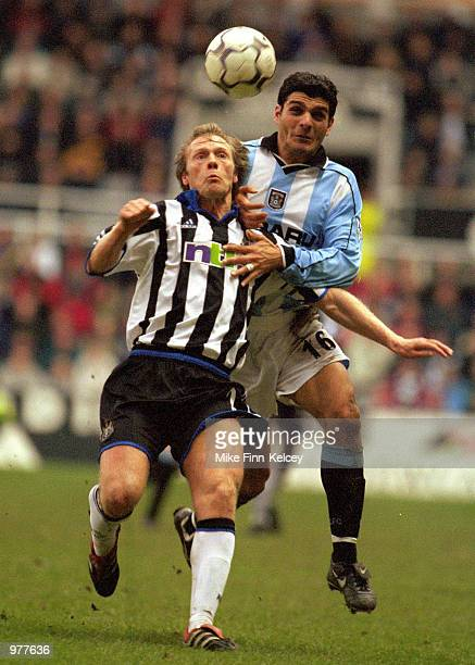Warren Barton of Newcaslte holds off John Aloisi of Coventry during the Newcastle United v Coventry City FA Carling Premiership played at St James''...
