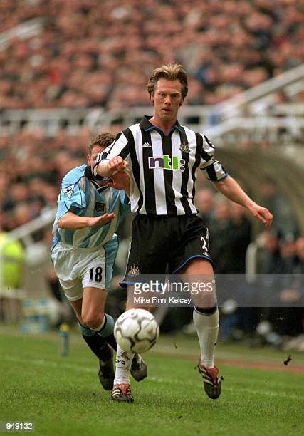 Warren Barton of Newcastle United takes the ball forward during the FA Carling Premiership match against Coventry City played at St James Park in...