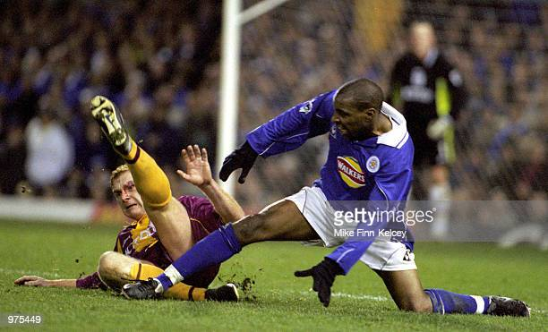 Wayne Jacobs of Bradford City recieves a late tackle from Trevor Benjamin of Leicester City during the FA Carling Premiership league match between...