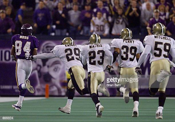 Wide receiver Randy Moss of the Minnesota Vikings takes off on a 68yard touchdown reception with the New Orleans Saints defense in tow during the...