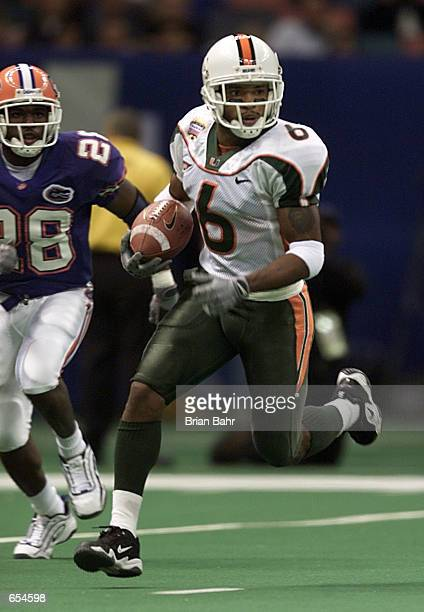 Wide receiver Santana Moss of the Miami Hurricanes runs against the Florida Gators during the second quarter of the Sugar Bowl at the Superdome in...