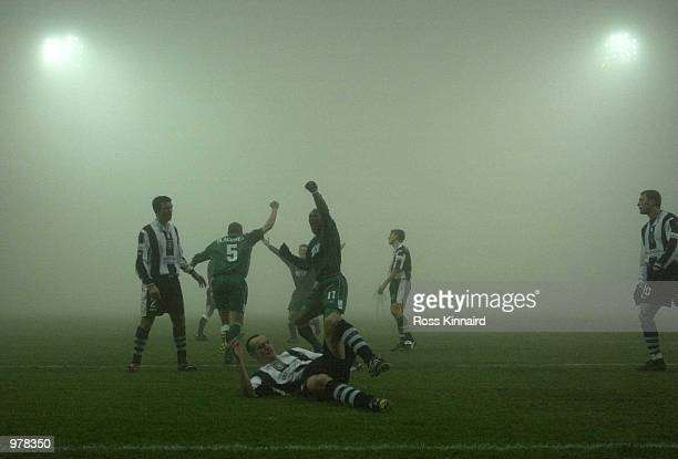 Wimbledon celebrate after Dean Blackwell scores in the fog during the AXA sponsored FA Cup third rourd replay between Notts County and Wimbledon at...