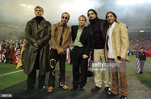 The Backstreet Boys stand on stage during the signing of the National Anthem during Super Bowl XXXV between the Baltimore Ravens and the New York...