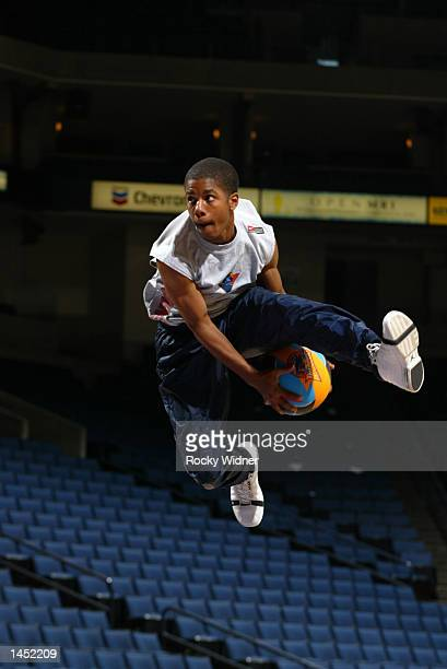 A member of the Thunder Dunk Team practices his high flying dunks before the Minnesota Timberwolves vs Golden State Warriors game at The Arena in...