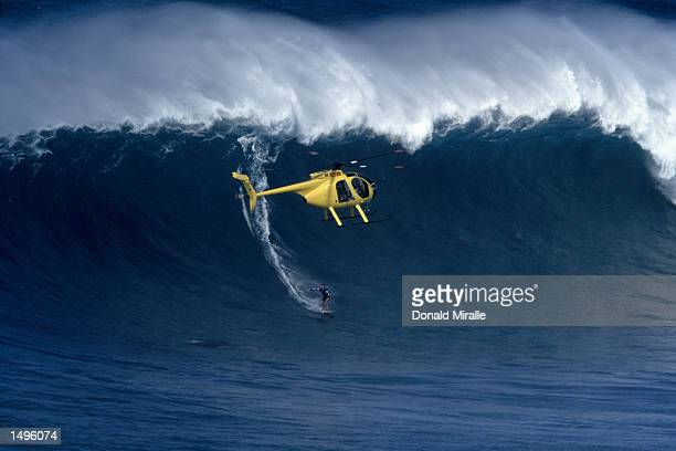 A surfer drops in at the Jaws TowIn World Cup in Pe'' Ahi Maui HawaiiMandatory Credit Donald Miralle/Getty Images