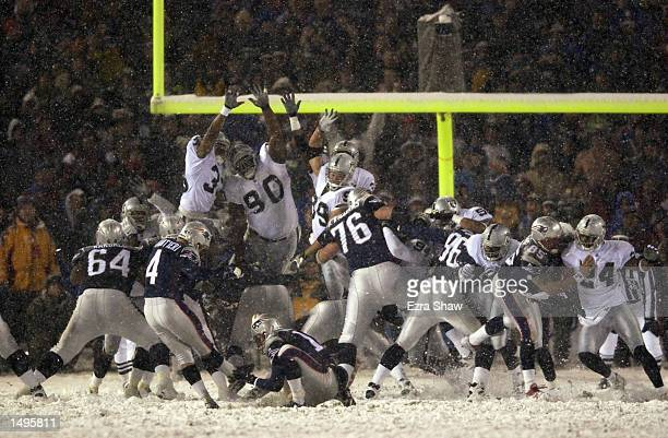 Adam Vinatieri of the New England Patriots kicks the winning field goal in overtime during the AFC playoff game against the Oakland Raiders at...