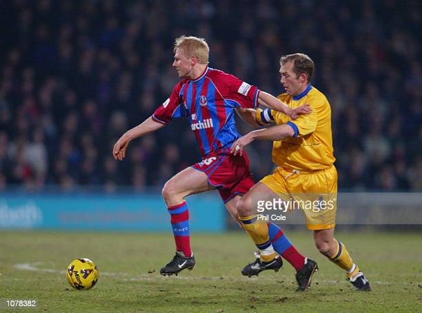 Aki Riihilahti of Crystal Palace tackles Paul Smith of Gillingham during the Nationwide League Division One game between Crystal Palace and...