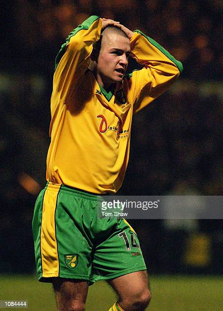 Alex Notman of Norwich City holds his head during the AXA Sponsored FA Cup third round match between Norwich City and Chelsea at Carrow Road,...
