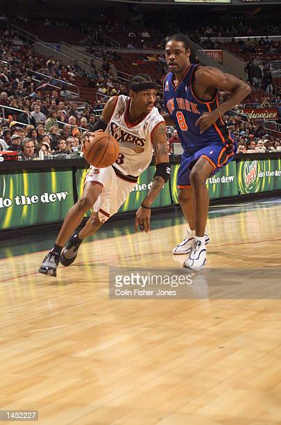 Allen Iverson of the Philadelphia 76ers blows by Latrell Sprewell of the New York Knicks at the First Union Center in Philadelphia Pennsylvania...