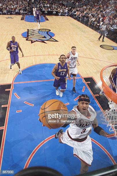 Allen Iverson of the Philadelphia 76ers lays a shot up during the game against the Los Angeles Lakers at the First Union Arena in Philadelphia...