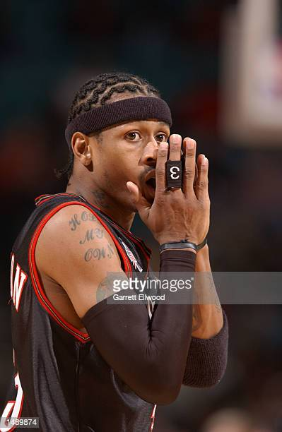 Allen Iverson of the Philadelphia 76ers reacts to a foul call against the Charlotte Hornets during the NBA game at the Charlotte Coliseum in...