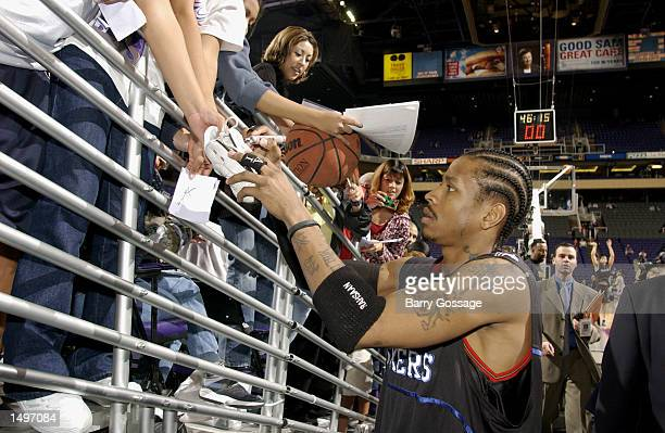 Allen Iverson of the Philadelphia 76ers signs autographs before their game against the Phoenix Suns at America West Arena in Phoenix AZ The 76ers won...