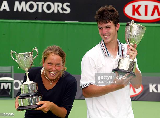 Barbora Strycova of the Czech Republic celebrates with the Girls Singles Trophy with Clement Morel of France who won the Boys Singles Trophy during...