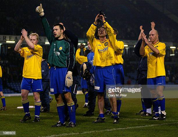 Canvey Island players applaud the fans after the AXA sponsored FA Cup third round match against Burnley played at Turf Moor in Burnley England...
