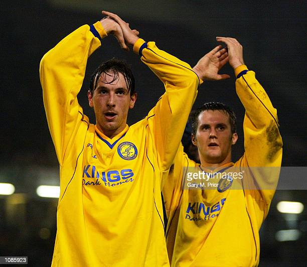 Canvey Island players Spencer Knight and Lee Boylan applaud the fans after the AXA sponsored FA Cup third round match against Burnley played at Turf...