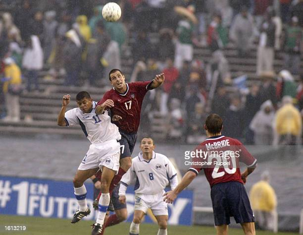 Carlos Bochanegra of the USA competes for a header against Ronald Cerritos of El Salvador during the first half of their CONCACAF Gold Cup...