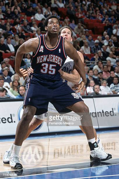 Center Jason Collins of the New Jersey Nets posts up guard Jud Buechler of the Orlando Magic during the NBA game at the TD Waterhouse in Orlando,...