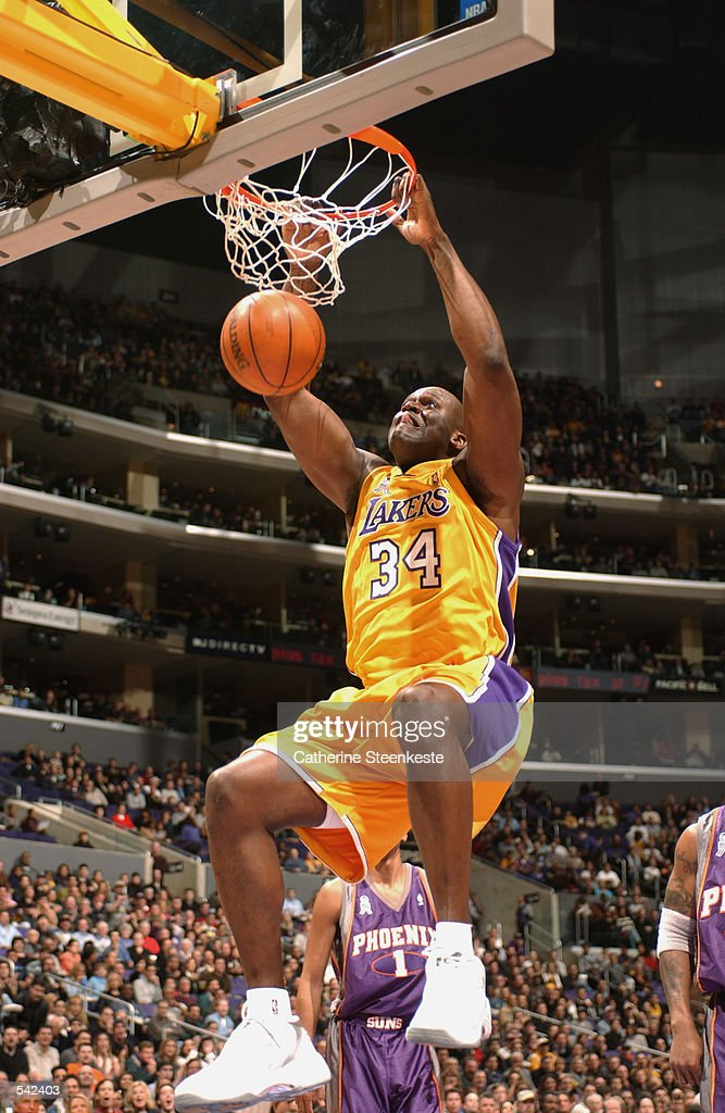 Center Shaquille O''Neal #34 of the Los Angeles Lakers dunks the ball during the NBA game against the Phoenix Suns at Staples Center in Los Angeles, California. The Lakers won 118-86. \ DIGITAL IMAGE.