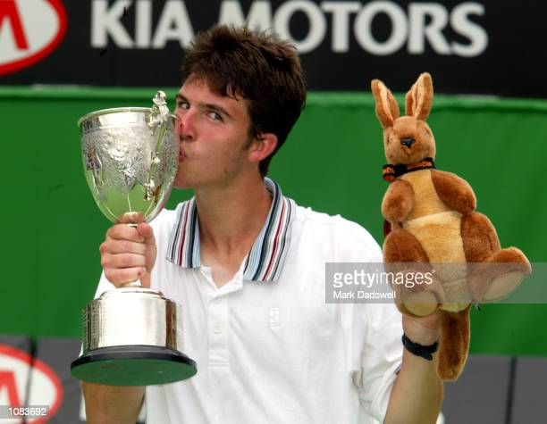 Clement Morel of France celebrates winning the Boys Singles Trophy after defeating Todd Reid of Australia during the Australian Open 2002 Tennis...