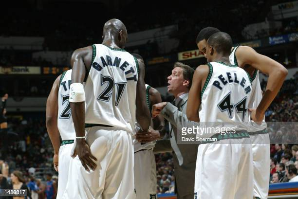 Coach Flip Saunders of the Minnesota Timberwolves gives his team some last minute instructions prior to the fourth quarter against the Detroit...