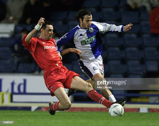 Corrado Grabbi of Blackburn Rovers takes the ball past Steve Chettle of Barnsley during the AXA sponsored FA Cup third round replay match played at...