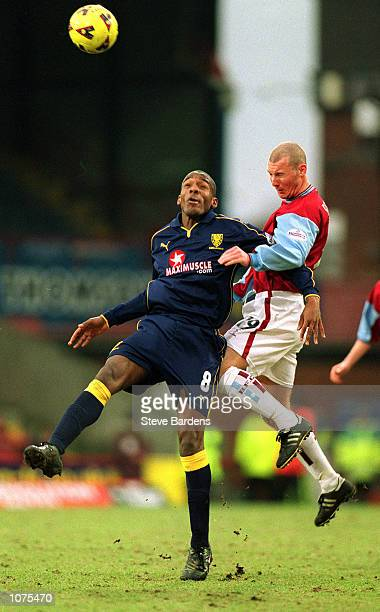 Damien Francis of WImbledon goes up for a header with Lee Briscoe of Burnley during the Nationwide Division One match between Wimbledon and Burnley...