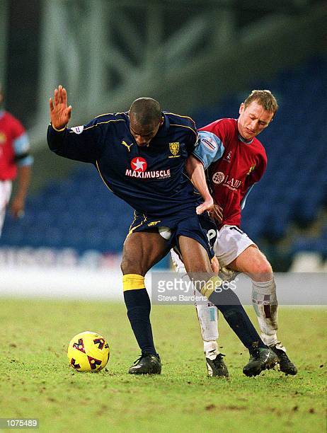 Damien Francis of Wimbledon holds off the challenge from Tony Grant of Burnley during the Nationwide Division One match between Wimbledon and Burnley...
