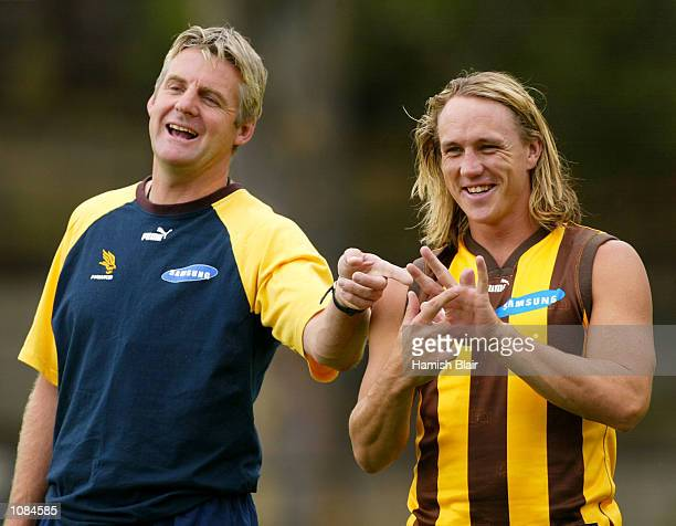 Daniel Chick of Hawthorn shares a joke with assistant coach Donald McDonald after Chick had a finger amputated at Hawthorn training Glenferrie Oval...