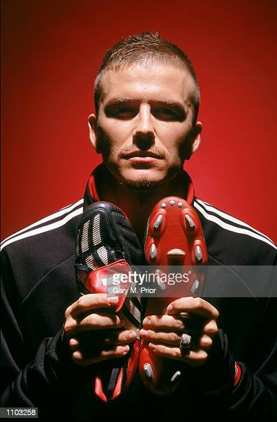 David Beckham of Manchester United and England with the new Adidas Predator Mania football boots during a photoshoot in Oxford England Mandatory...
