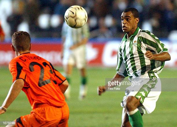 Denilson of Betis and Curro Torres of Valencia in action during the Spanish Primera Liga match played between Betis and Valencia at the Ruiz de...