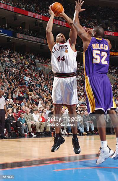 Derrick Coleman of the Philadelphia 76ers puts a shot up over Samaki Walker of the Los Angeles Lakers during their game at the First Union Arena in...
