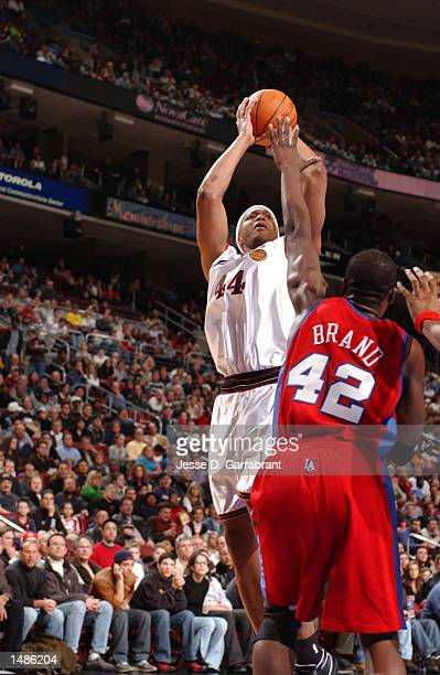 Derrick Coleman of the Philadelphia 76ers shoots over Elton Brand of the Los Angeles Clippers at the First Union Center, Philadelphia, Pennsylvania....