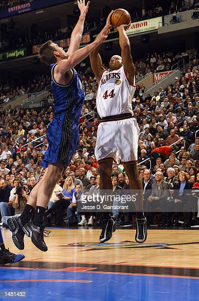 Derrick Coleman of the Philadelphia 76ers shoots over Pat Garrity of the Orlando Magic at the First Union Center, Philadelphia, Pennsylvania. DIGITAL...