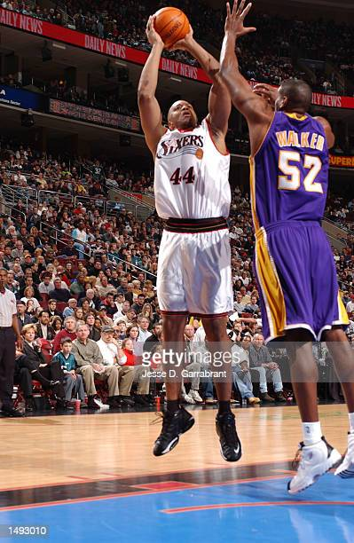 Derrick Coleman of the Philadelphia 76ers shoots over Samaki Walker of the Los Angeles Lakers at the First Union Center Philadelphia Pennsylvania...