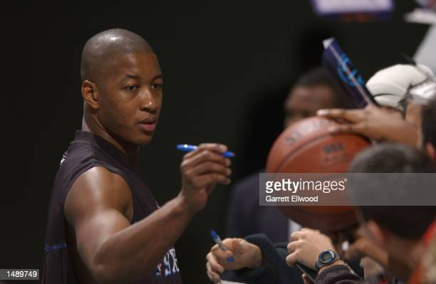 Eric Snow of the Philadelphia 76ers signs autographs before playing the Charlotte Hornets at the Charlotte Coliseum in Charlotte North Carolina...