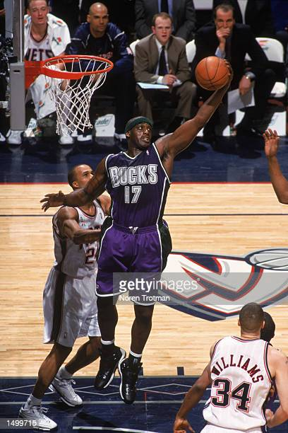 Forward Anthony Mason of the Milwaukee Bucks grabs a rebound during the NBA game against the New Jersey Nets at Continental Airlines Arena in East...