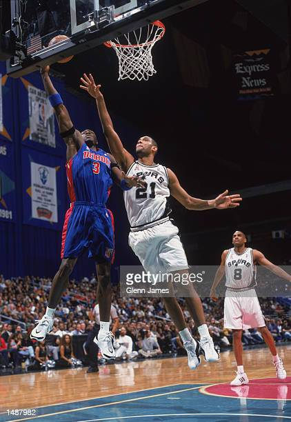 Forward Ben Wallace of the Detroit Pistons shoots past center Tim Duncan of the San Antonio Spurs during the NBA game at the Alamodome in San Antonio...