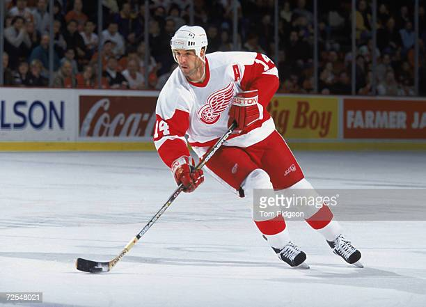 Forward Brendan Shanahan of the Detroit Red Wings skates with the puck during the NHL game against the Ottawa Senators at Joe Louis Arena in Detroit...