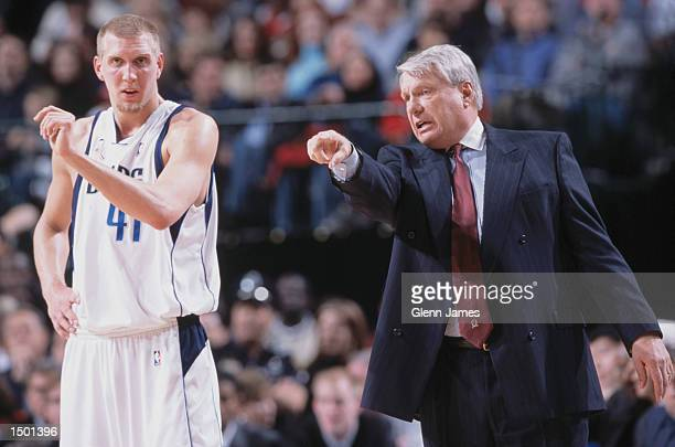 Forward Dirk Nowitzki of the Dallas Mavericks listens to head coach Don Nelson during the NBA game against the Houston Rockets at the American...