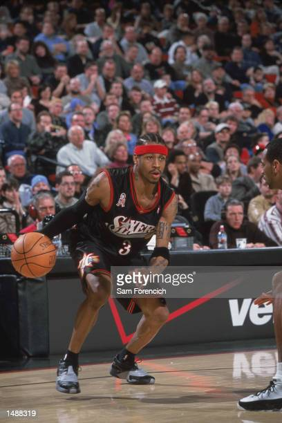 Guard Allen Iverson of the Philadelphia 76ers dribbles the ball during the NBA game against the Portland Trail Blazers at the Rose Garden in Portland...
