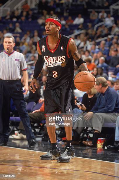 Guard Allen Iverson of the Philadelphia 76ers dribbles the ball during the NBA game against Phoenix Suns at the America West Arena in Phoenix Arizona...