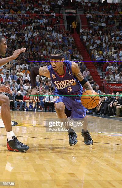 Guard Allen Iverson of the Philadelphia 76ers dribbles the ball during the NBA game against the Miami Heat at American Airlines Arena in Miami...