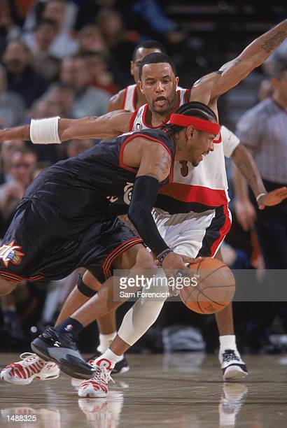 Guard Allen Iverson of the Philadelphia 76ers drives past point guard Damon Stoudamire of the Portland Trail Blazers during the NBA game at the Rose...
