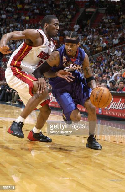 Guard Allen Iverson of the Philadelphia 76ers drives past guard Eddie Jones of the Miami Heat during the NBA game at American Airlines Arena in Miami...